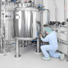photo taking samples at tank in clean room
