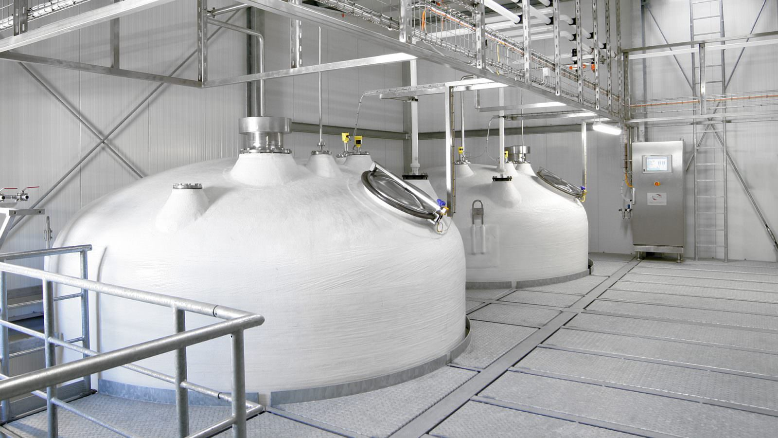 photo of two storage tanks for liquid seasoning